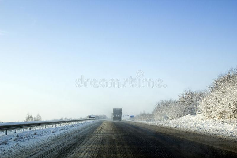 Winter foggy highway, bad weather and driving cars stock photos