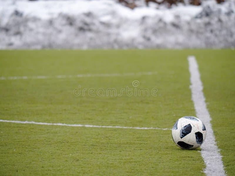 Winter football playground, snow pilled around. Winter football playground with plastic grass, snow pilled around field royalty free stock image
