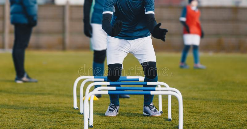 Winter Football Soccer Training Session with Hurdles. Athlete Player Practice Hurdles. Winter Football Soccer Training Session with Hurdles. Athlete Player royalty free stock photography