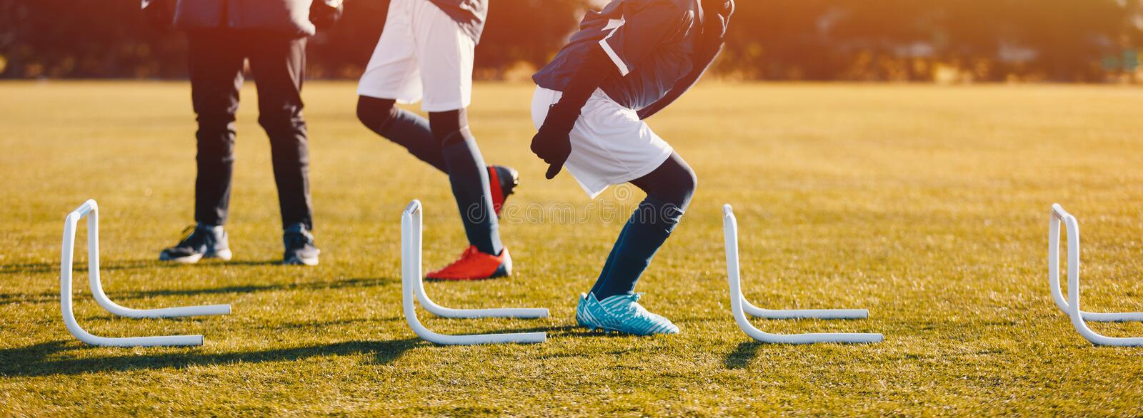 Winter Football Soccer Training Session with Hurdles. Athlete Player Practice Hurdle Jump stock photography