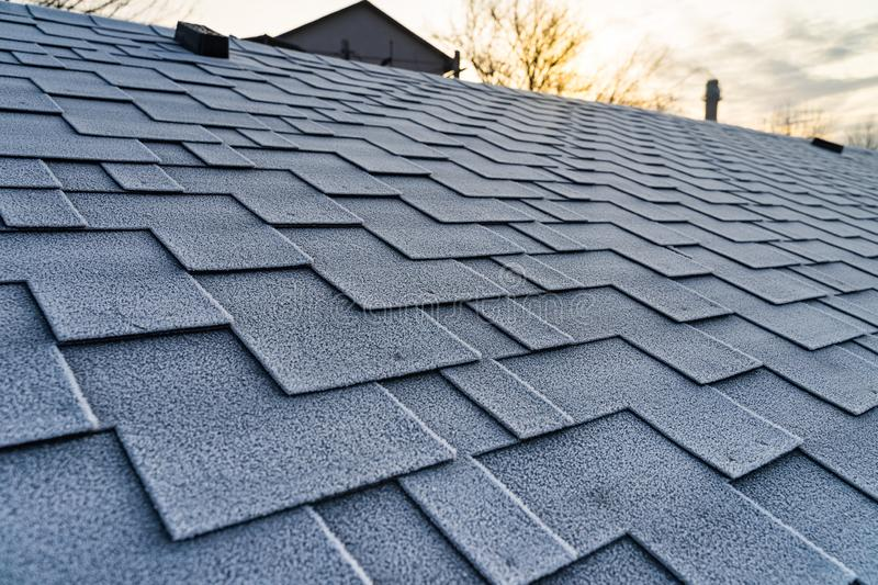 Winter frost on the asphalt roofing shingles. Winter frost on the asphalt roofing shingles royalty free stock photos