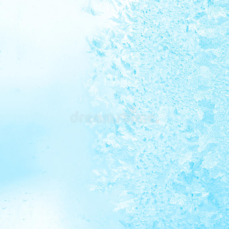 Winter frost blue patterns on window, festive background, close stock photos