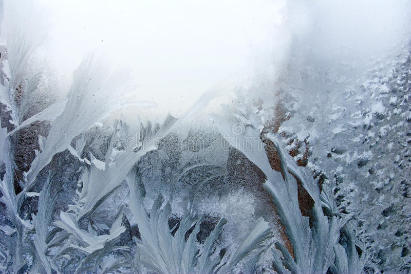 Winter frost on the window as background. Abstract image of winter frost on the window as background royalty free stock photo