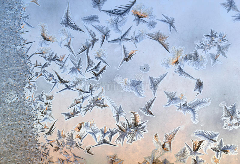 Winter frost on window glass. Under the sunlight royalty free stock images