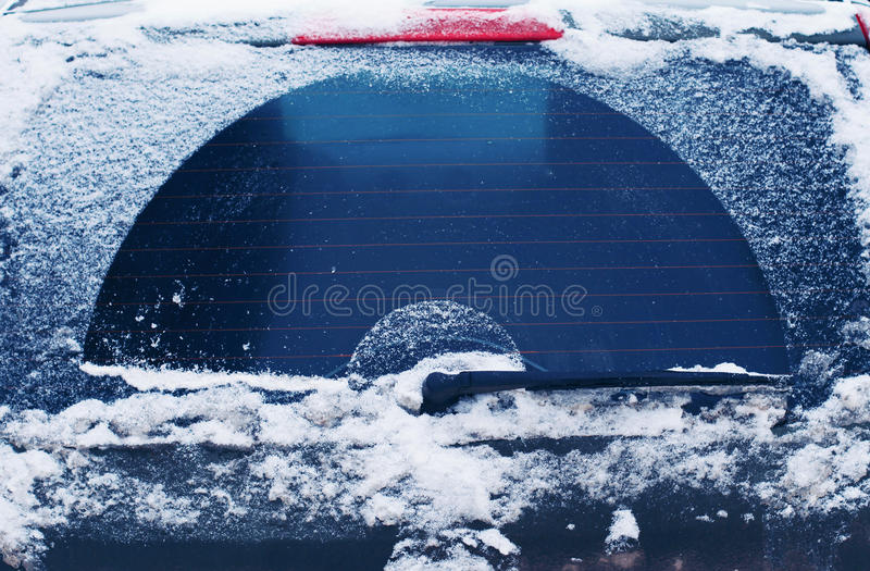Winter frozen back car window, texture freezing ice glass stock image