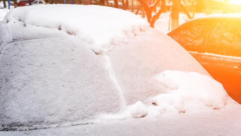 Winter frozen back car window, texture freezing ice glass background. Winter day stock photos