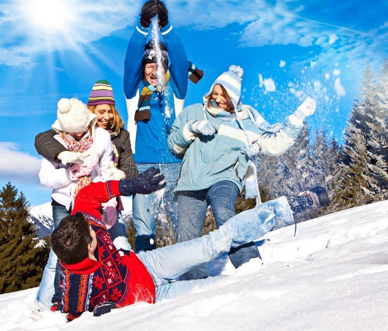 Winter fun 22. Cute family having fun in the snow stock photos