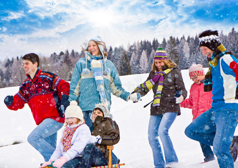 Winter fun 24. Cute family having fun in the snow stock photography