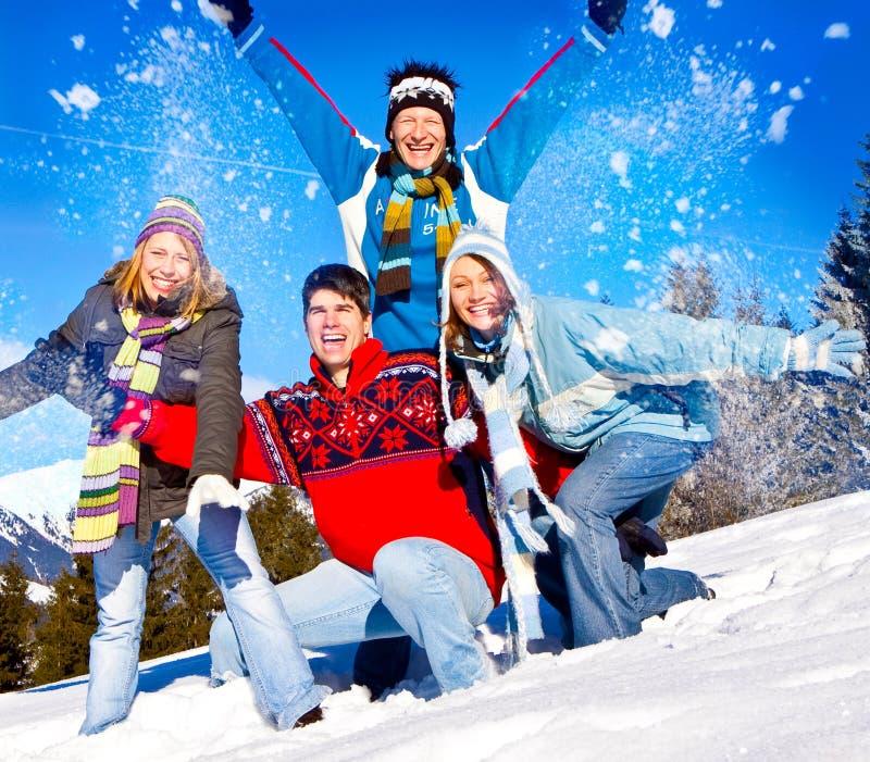 Winter fun 26. Cute family having fun in the snow royalty free stock photos