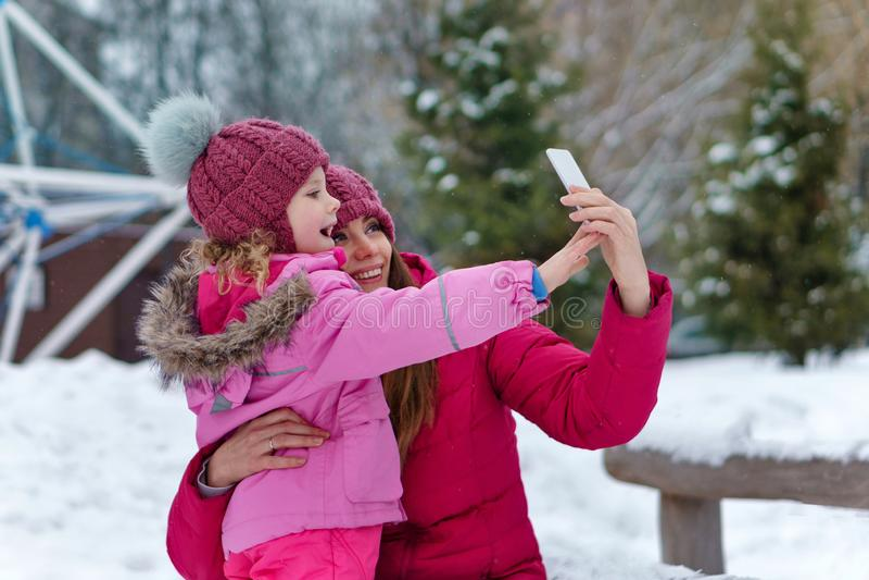 Winter fun family stock photos