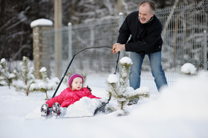 Winter Fun: Having A Ride On A Snow Shovel Stock Images