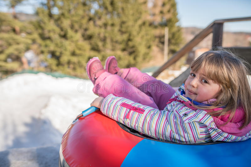 Winter fun in a inflatable tube royalty free stock photography