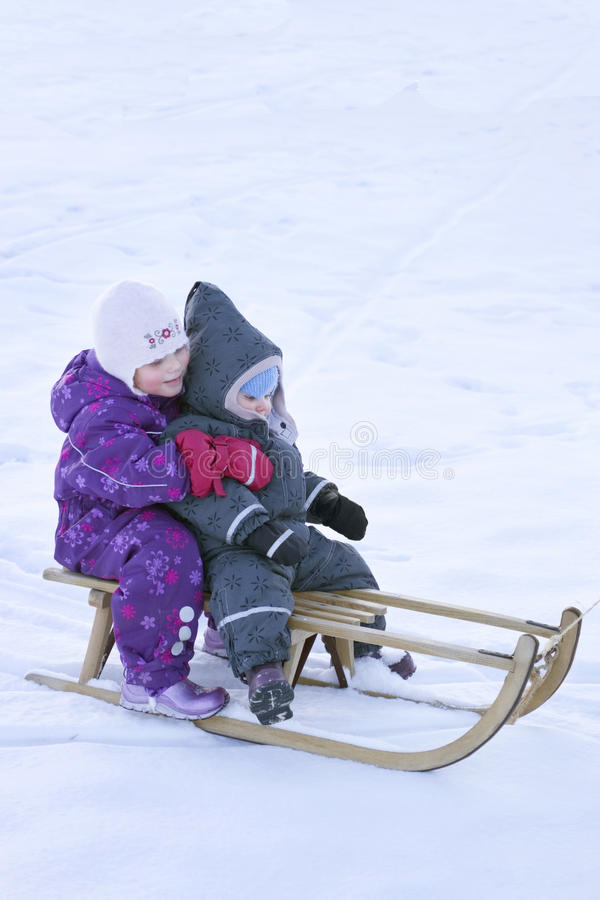 Winter fun - Kid sledging downhill stock photos