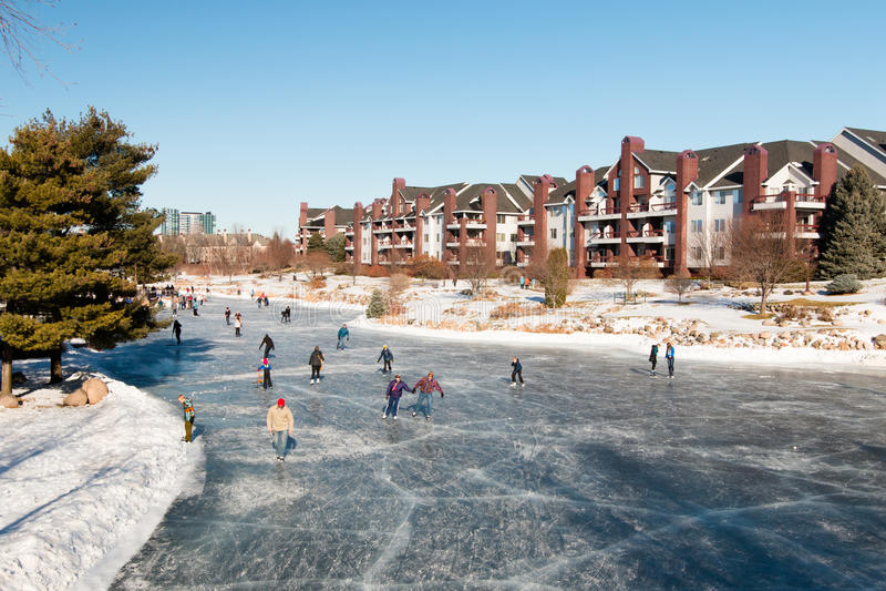 Winter fun on an outdoor ice-skating rink. Minnesota, USA royalty free stock image
