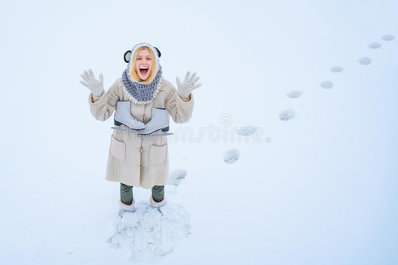 Winter game. Beautiful woman enjoying first snow. Portrait of a happy teenage girl in the snow. Winter young woman royalty free stock photo