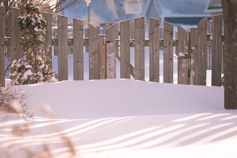 Winter Garden Gate. Garden gate of a suburban garden buried in snow stock photo
