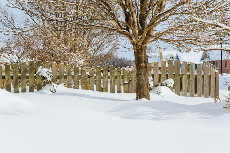 Winter Garden Gate. Garden gate of a suburban garden buried in snow royalty free stock photo