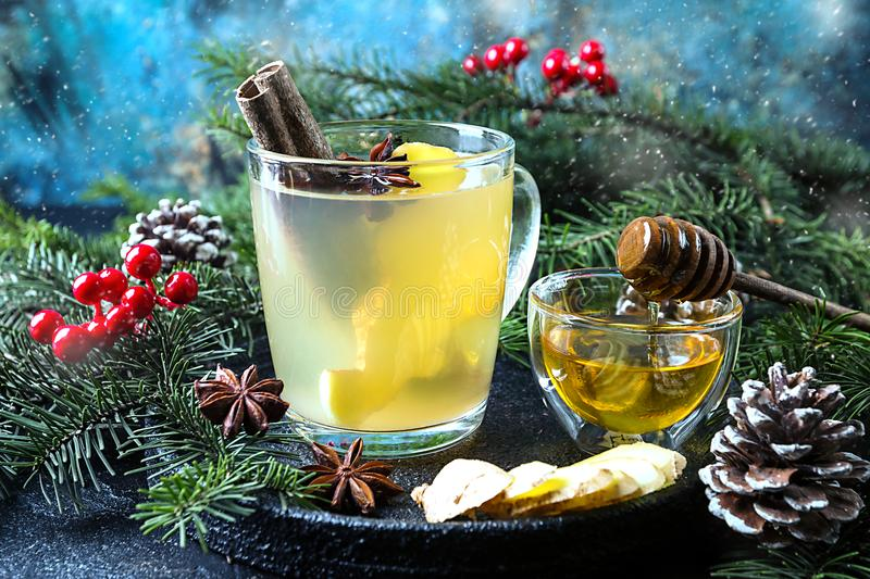 Winter Ginger drink. In glass cup with christmas decorations royalty free stock image