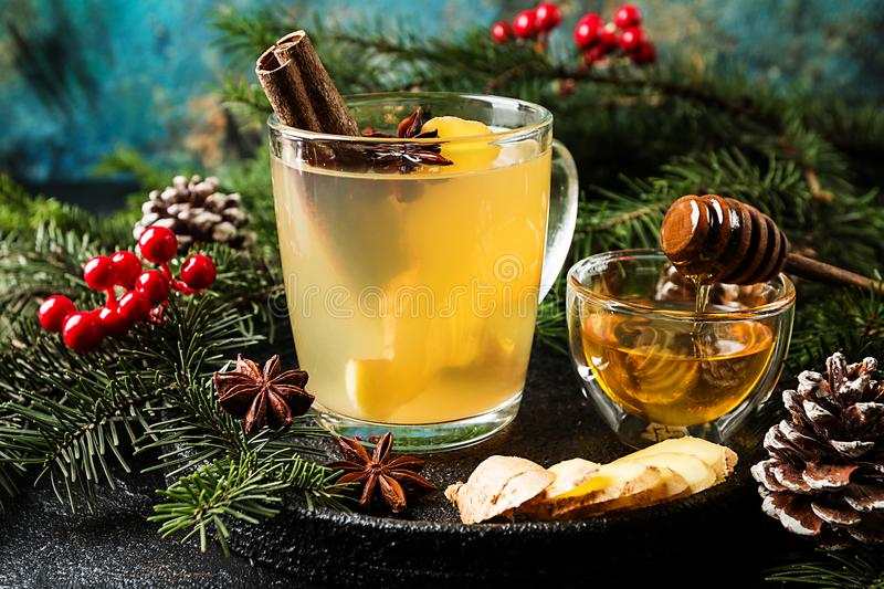 Winter Ginger drink. In glass cup with christmas decorations stock photography