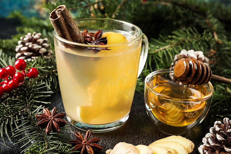 Winter Ginger drink. In glass cup with christmas decorations stock photo