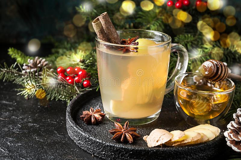 Winter Ginger drink. In glass cup with christmas decorations royalty free stock photos