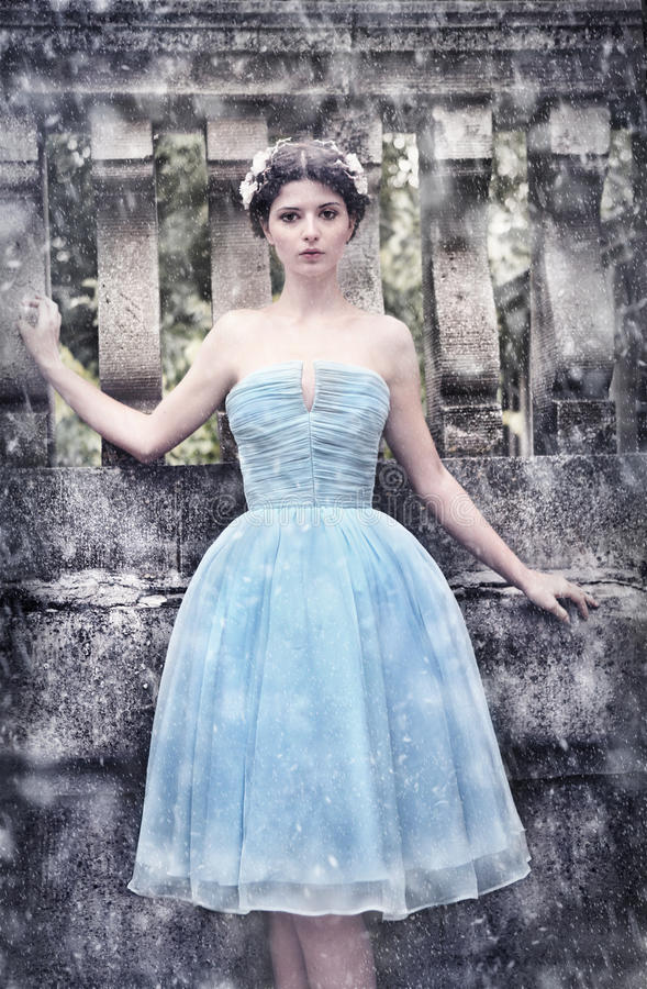 Winter girl in blue silk gown stock photo
