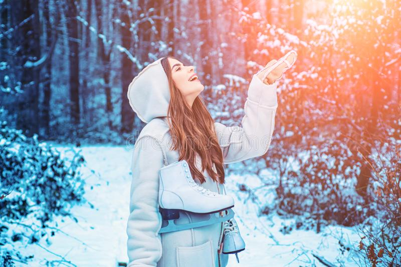 Winter girl having fun in winter park. Global cooling. Winter portrait of young woman in the winter snowy scenery. royalty free stock photography