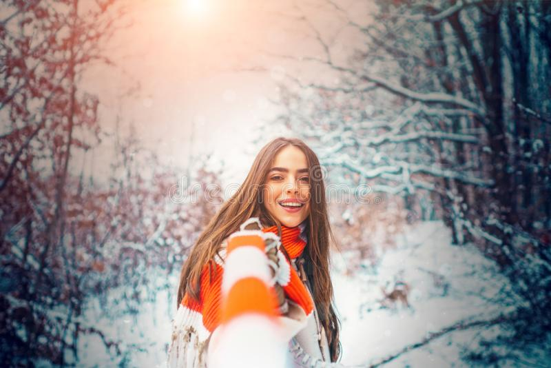 Winter girl on nature wintertime. Outdoors. Laughing Girl Outdoors. Outdoor close up portrait of young beautiful girl royalty free stock images