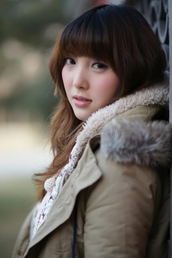 Winter girl in the park stock images