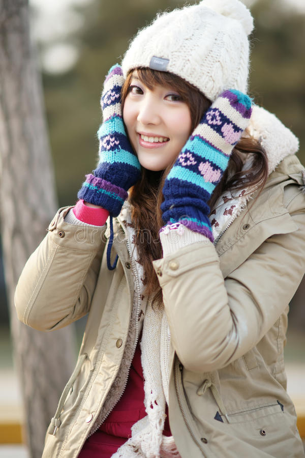 Winter girl in the park royalty free stock images