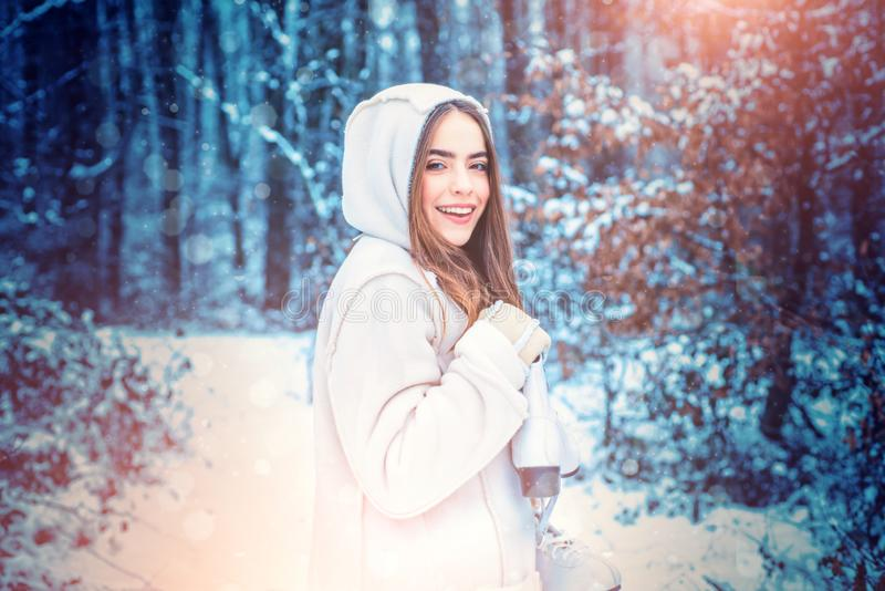 Winter girl. Portrait of young beautiful brunette woman in snow Garden. People in snow. stock image