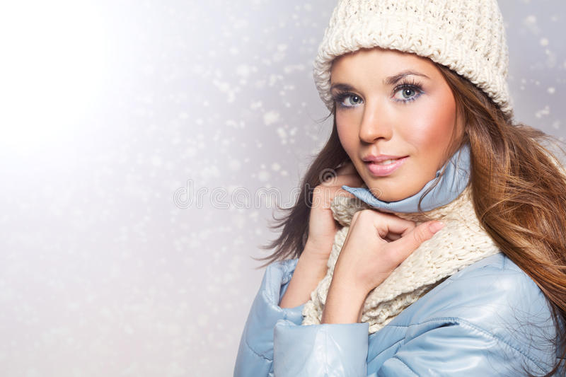 Winter girl in white cap royalty free stock image