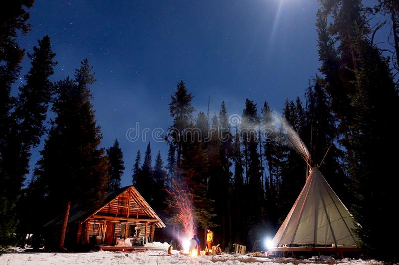Winter Glamping 1. Night time long exposure of a winter getaway royalty free stock photo