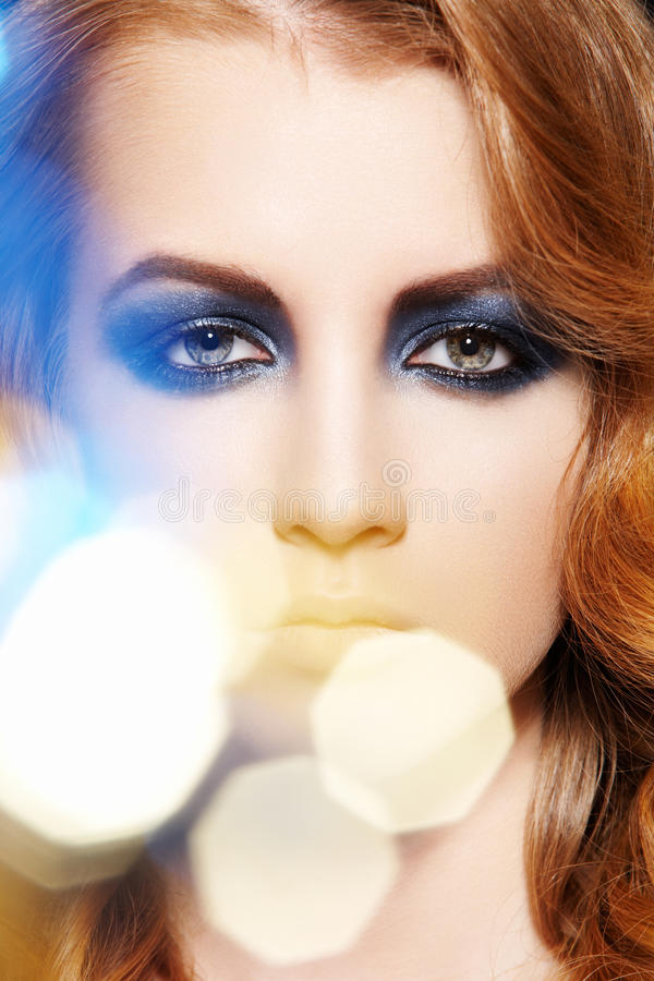 Winter glitter make-up, curly hair. Fashion model stock photos
