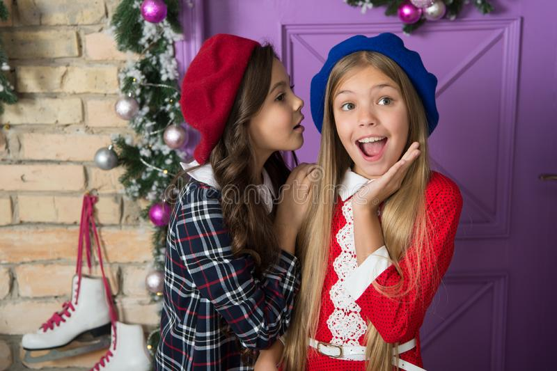 Winter gossips concept. Girls small kids front festive christmas decorations. Lets have fun and celebrate christmas. Christmas tips for kids. Children cute stock images