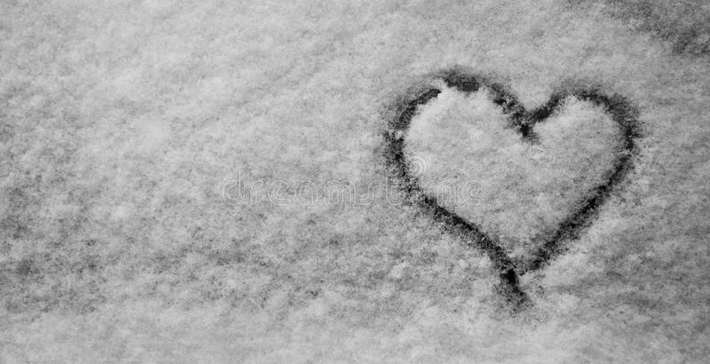Winter. Hand Drawn Heart Shape in the fresh Snow. Black and White. Banner. royalty free stock photos