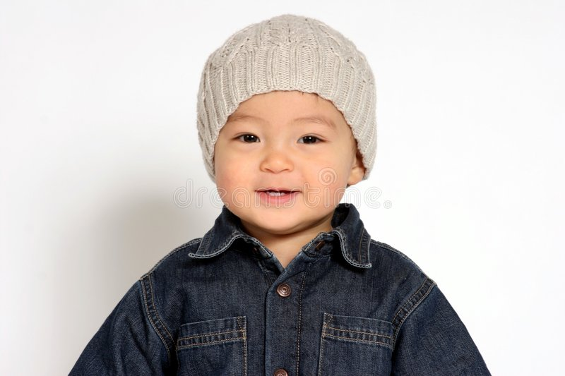 Winter Hat. A toddler boy wearing his winter hat royalty free stock photography