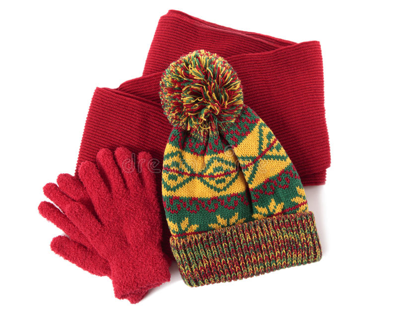 Winter hat, red scarf and gloves isolated on white background stock photography