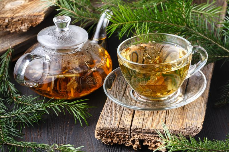 Winter healing orange drink with sea buckthorn, rosemary, spice, fir branches royalty free stock images