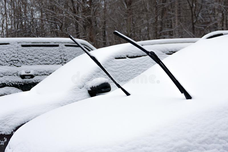 Winter. Heavy snowfall in the city. Cars heavily snowbound. Car wipers stick out from under the snow royalty free stock images