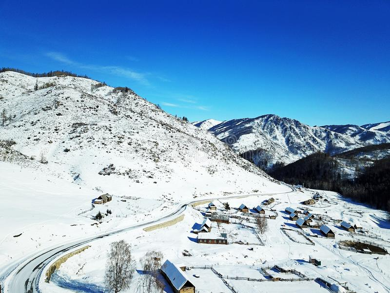 Winter Hemu village in Xinjiang, China. Heavy snow-covered wooden houses in Hemu village in winter. Located within the Kanas Lake scenic area in the north of stock image