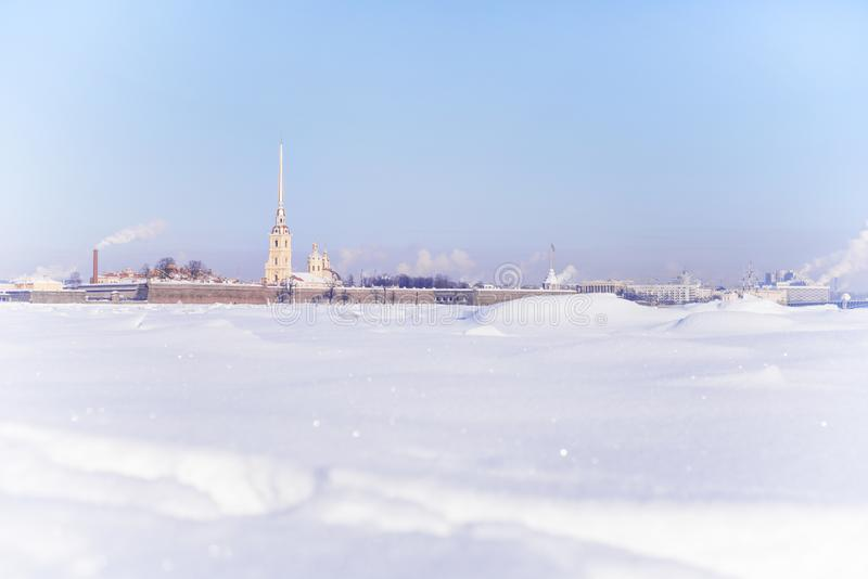 Winter high key view of Peter and Paul fortress in Saint Petersburg, Russia. Winter high key landscape of Saint Petersburg, Russia. Peter and Paul fortress view royalty free stock photography
