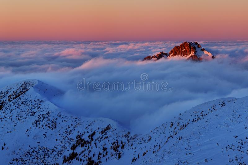 Winter High Tatras mountain range panorama with many peaks and clear sky. Sunny day on top of snowy mountains. stock photo
