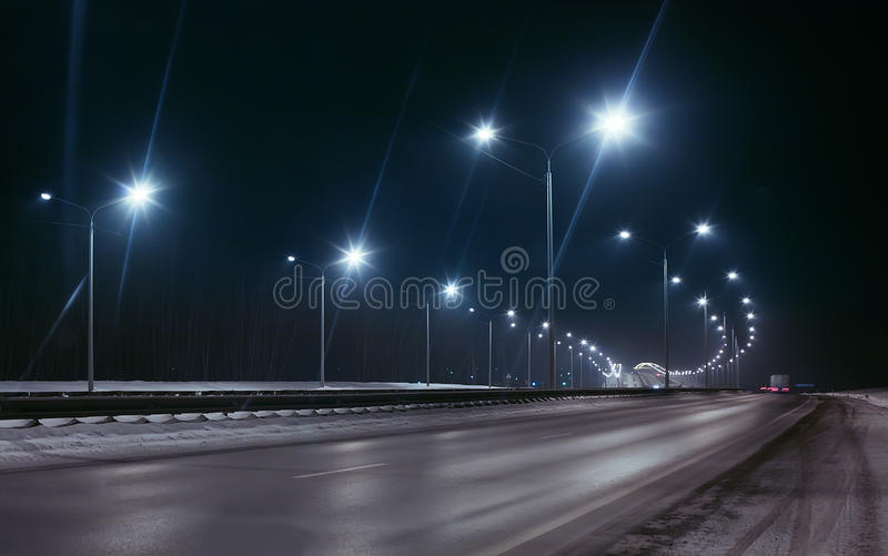 Winter highway. At night shined with lamps royalty free stock photos