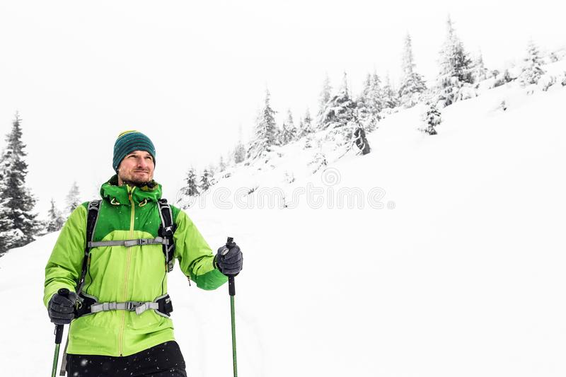 Winter hike in white, man and adventure concept royalty free stock images
