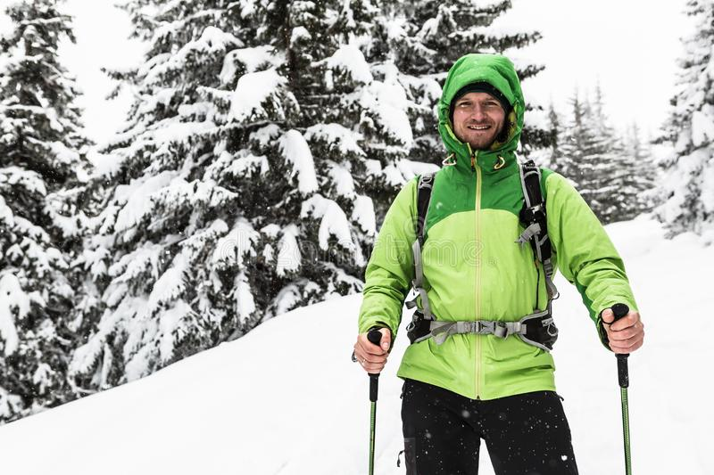 Winter hike in white snowy woods, man hiking royalty free stock images