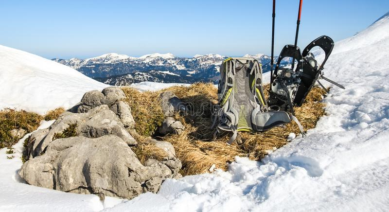 Winter hiking equipment. Backpack and snowshoes on top of mountain. stock images