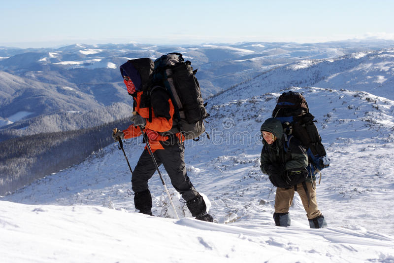 Winter hiking in the mountains on snowshoes stock photos