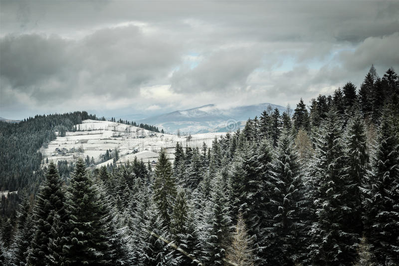 Winter hills with cloudy sky. royalty free stock photography
