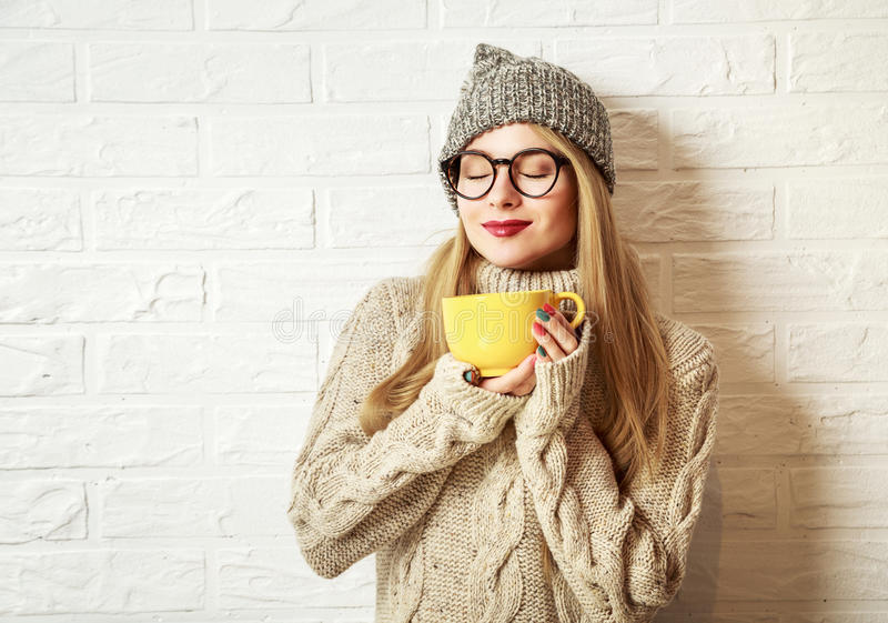 Winter Hipster Girl Enjoying a Cup of Hot Tea royalty free stock images